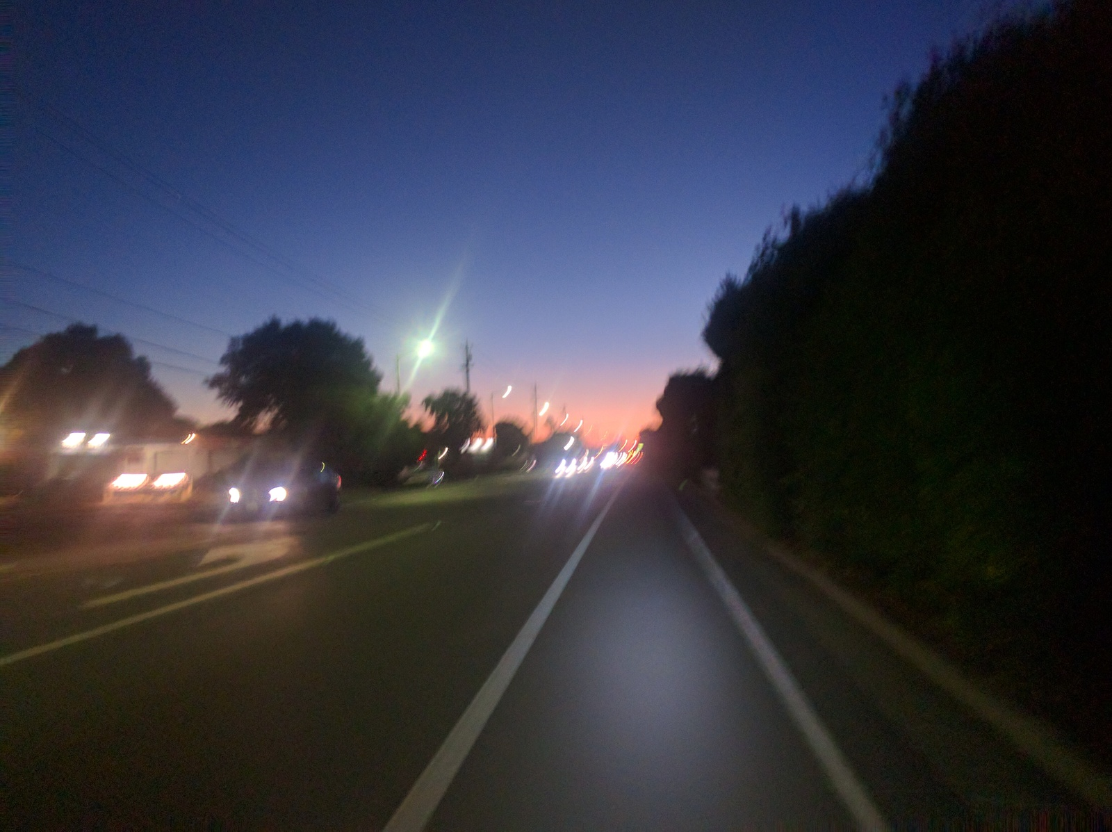 Evelyn Ave bike lane, blurry, as the sun sets