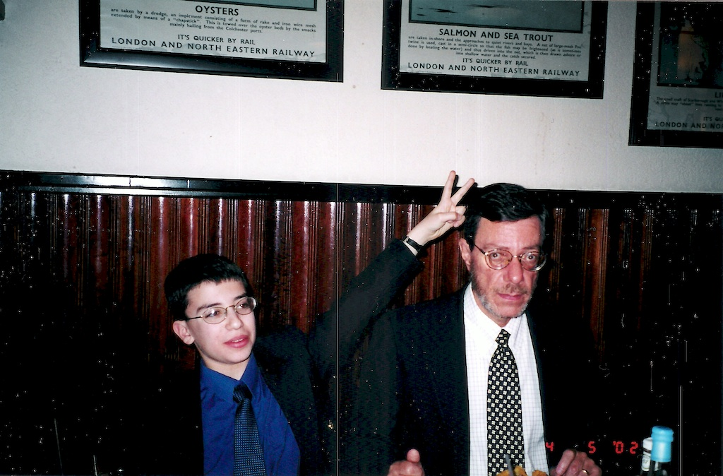 A very young Joshua giving his father bunny ears
